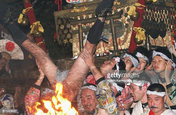Men carry portable a shrine back to a shrine during Kurama Fire Festival on October 22 2004 in the vicinity of Yukijinja Shrine in Kurama area Kyoto...
