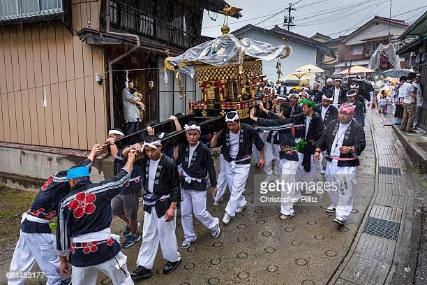 Men carry Shinto's Mikoshi during summer festival