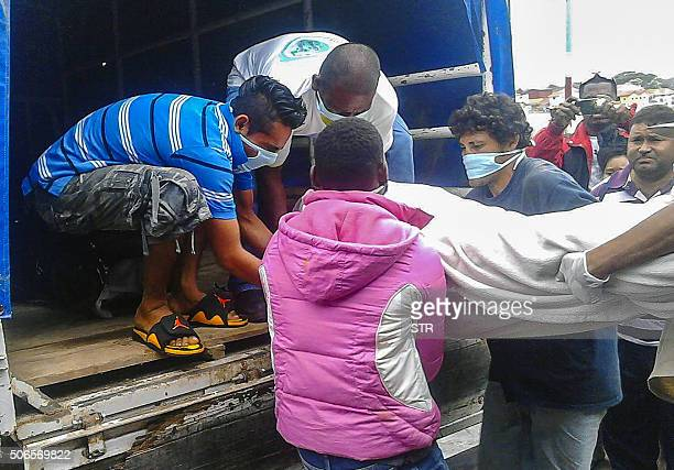 Men carry the body of one of 13 Costa Ricans who died in a boating accident two nautical miles from Little Corn Island off the Caribbean coast of...