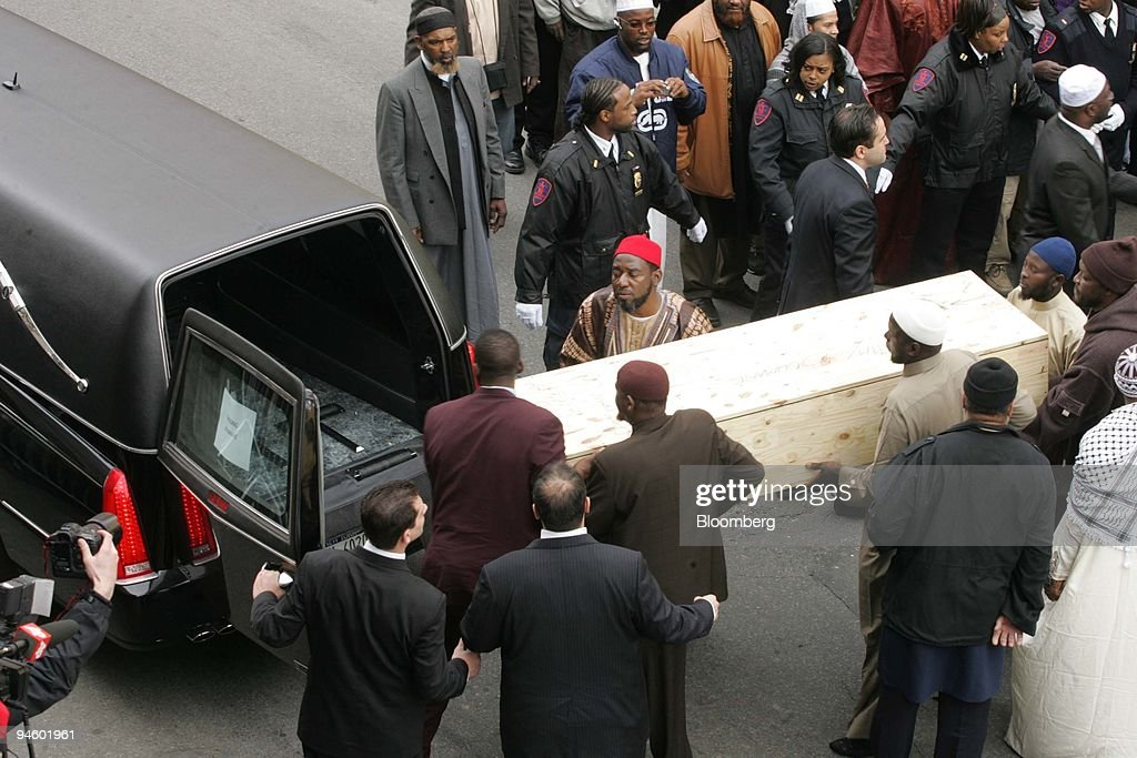 Men carry the caskets of people who were killed in a Bronx