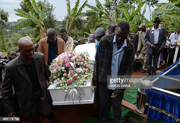 Men carry the coffin of Angela Nyokabi who was killed during the attack on Garissa University during her funeral in her home village of Kiambu on...
