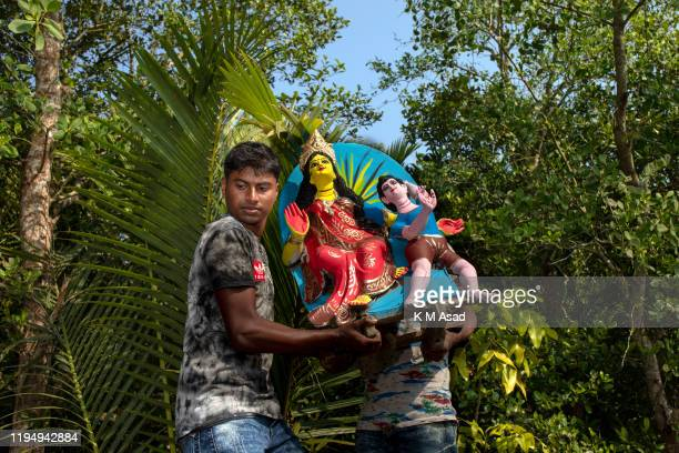 Men carry the Hindu God to celebrate Bonbibi festival at Sundarbans in Khulna Bonbibi the lady of the forest is a guardian spirit of the forests...