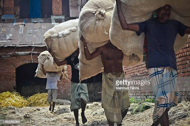 Men carrying bags