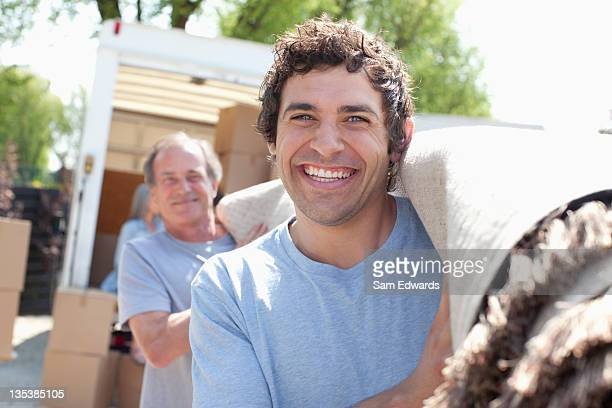 men carrying carpet from moving van - carrying stock pictures, royalty-free photos & images