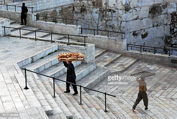 men carrying racks for bread on their heads. - palestinian stock photos and pictures