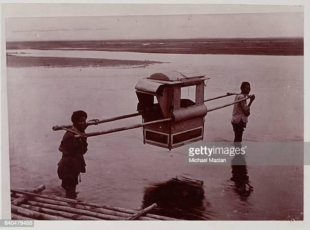Men Carrying Sedan Chair Across River in China