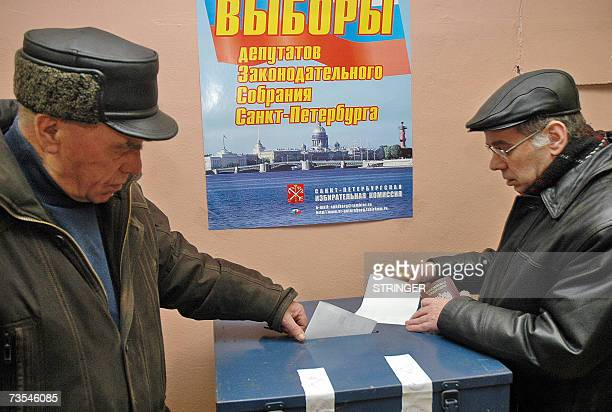 Men cast their ballots at a polling station during regional elections in St Peteresburg 11 March 2007 Voters are going to the polls in 14 Russian...