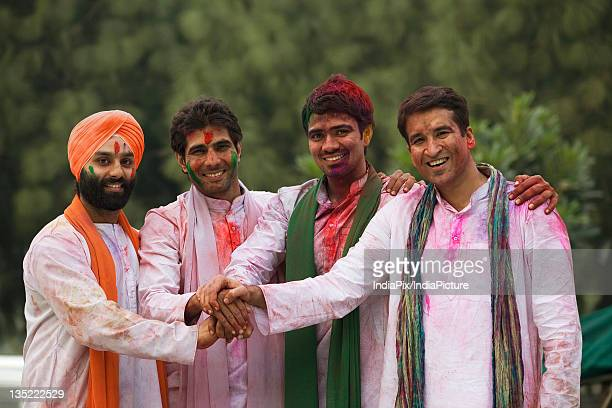 Men celebrating Holi