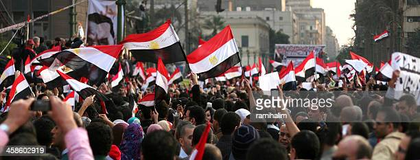 men celebrating mubarak's step down in tahrir sq. - mexican revolution stock photos and pictures