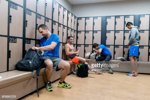 Men changing in the locker room at the gym