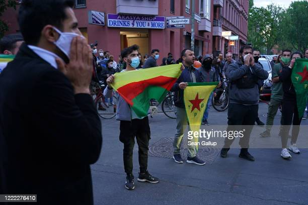 Men chant proKurdish slogans during scattered leftwing protests in Kreuzberg district on May Day during the novel coronavirus crisis on May 1 2020 in...