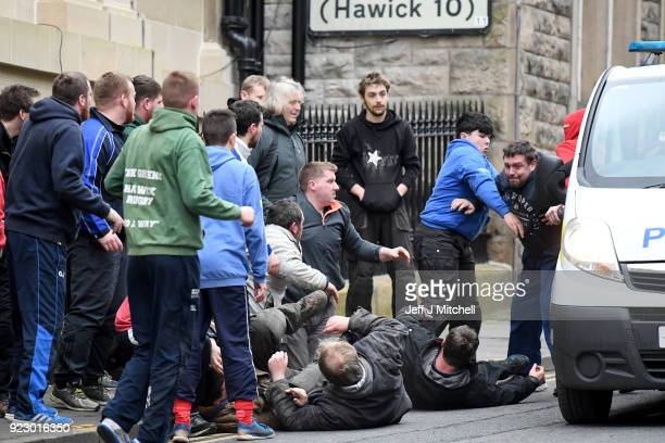 Men chase after the leather ball during the annual 'Fastern Eve Handba' event in Jedburgh's High Street in the Scottish Borders on February 22 2018...