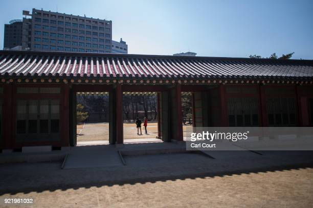 Men chat as they visit Deoksugung Palace on February 21 2018 in Seoul South Korea With tourists visiting from around the world leaders from South...