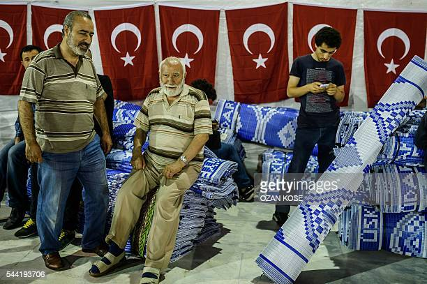 Men chat before praying at the new Camlica mosque in Istanbul on July 1 2016 Istanbul's towering Camlica mosque received its first worshippers as...