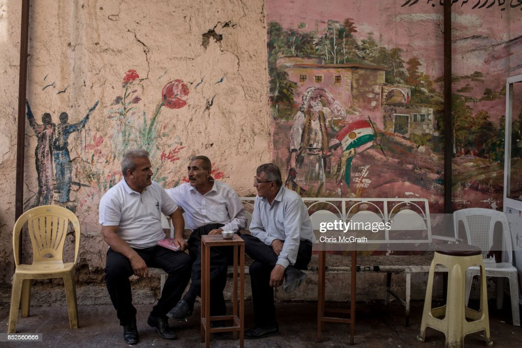 Men chat in front of a Kurdish mural ahead of the upcoming referendum for independence of Kurdistan on September 23, 2017 in Sulaymaniyah, Iraq. The Kurdish Regional government is preparing to hold the September 25, independence referendum despite strong objection from neighboring countries and the Iraqi government, which voted Tuesday to reject Kurdistan's referendum and authorized the Prime Minister Haider al-Abadi to take measures against the vote. Despite the mounting pressures Kurdistan President Masoud Barzani continues to campaign and state his determination to go ahead with the vote.