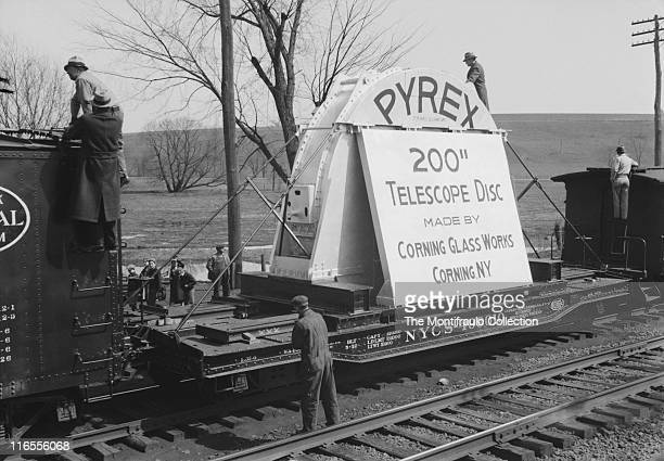 Men checking on the protective structure around the 200 inch Hale Pyrex MirrorTelescope disc made by Corning Glass Works of Corning, New York during...