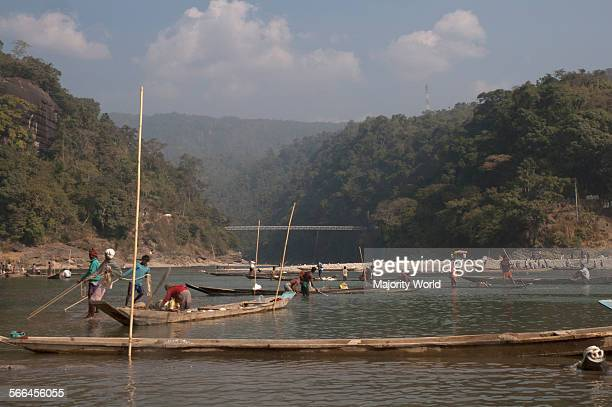 Men collect stones from the bed of Dauki river Jaflong Sylhet Bangladesh January 20 2010