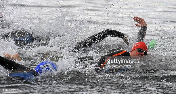 Men compete during the men's elite race, as 10,000 swimmers, in waves of 300, take part in the Great North swim in Lake Windermere, Cumbira, northern...