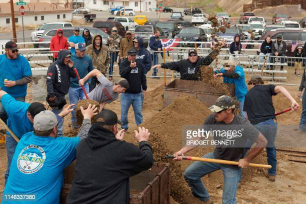 Men compete in team mucking during the Nevada State Mining Championship in Tonopah, Nevada on May 25 during Jim Butler Days, founder of the town...