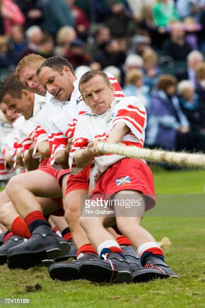 Men compete in Tug O' War contest at the Braemar Games Highland Gathering Scotland UK