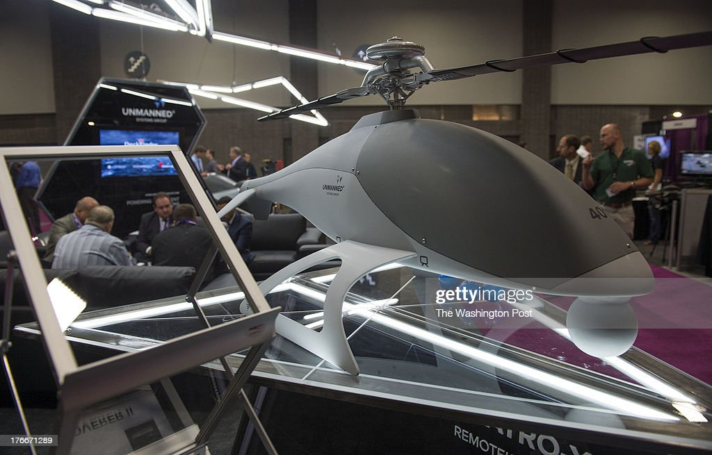 Men conduct business behind a Unmanned Systems ATRO-X