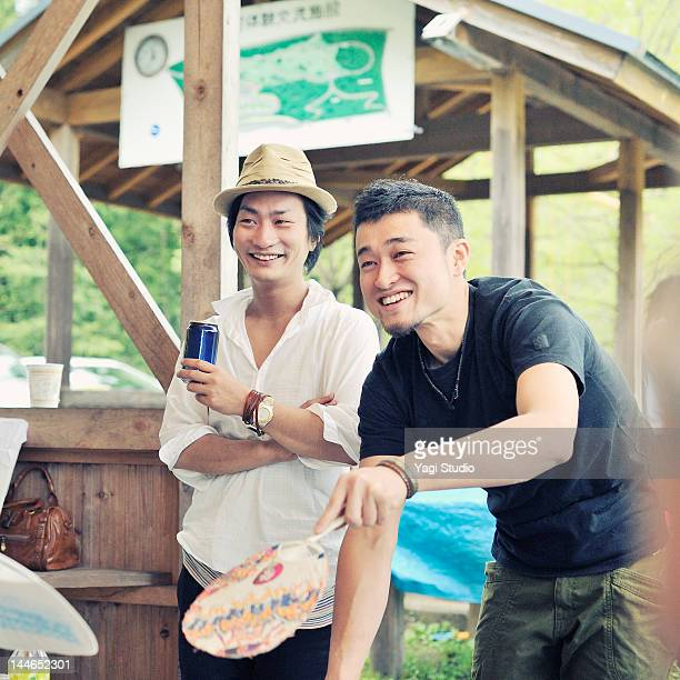 Men conversing over grill