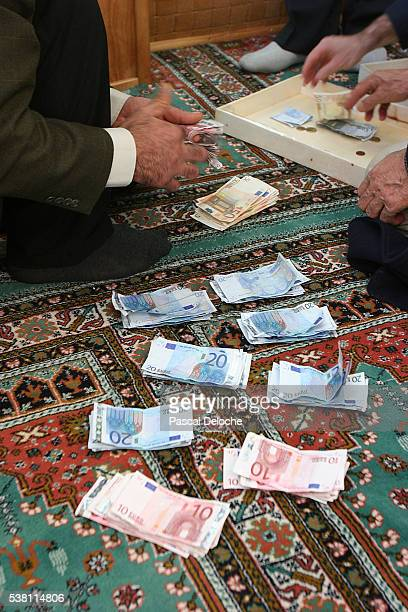 men counting offerings at mosque - sallanches stock pictures, royalty-free photos & images