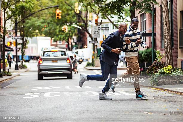 Men couple crossing the street New York City