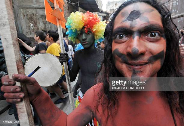 Men covered in body paint and dressed up parade in a street during the annual festival of Zambo that celebrates the beginning of lent the Christian...