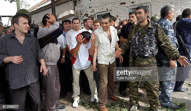 Men cry during the rescue operation in Beslan's school northern Ossetia 03 September 2004 Dozens of corpses of dead hostages are currently inside the...