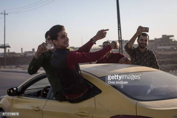 Men dance and sing from a car as they celebrate a wedding in West Mosul on November 3 2017 in Mosul Iraq Five months after Mosul Iraq's secondlargest...