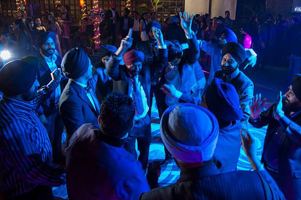 Men dance at Sikh engagement party