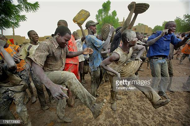 men dance & celebrate in mud, djenne, mali - indigenous culture stock pictures, royalty-free photos & images