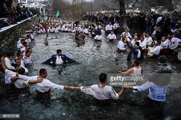 Men dance in the icy winter waters of the Tundzha river in the town of Kalofer as part of the Epiphany Day celebrations on January 6 2015 As a...