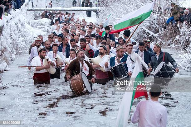 Men dance in the icy winter waters of the Tundzha river in the town of Kalofer as part of the Epiphany Day celebrations on January 6 2017 As a...