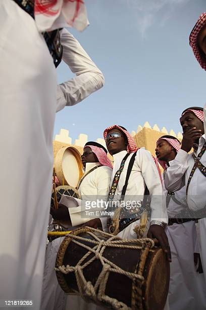 Men dance in traditional dress at the Janadriya Festival, Riyadh, Saudi Arabia
