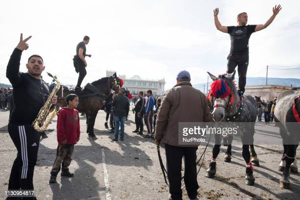 Men dance on horseback to a live band during Horse Easter celebrations in the Fakulteta neighborhood of Sofia March 16 2019 which is celebrated on St...
