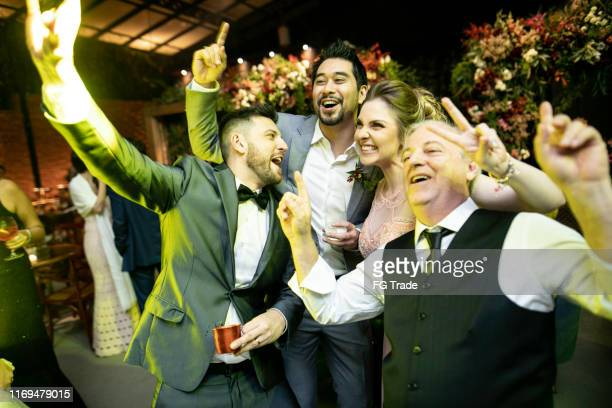men dancing and enjoying a wedding party - passed out drunk stock pictures, royalty-free photos & images