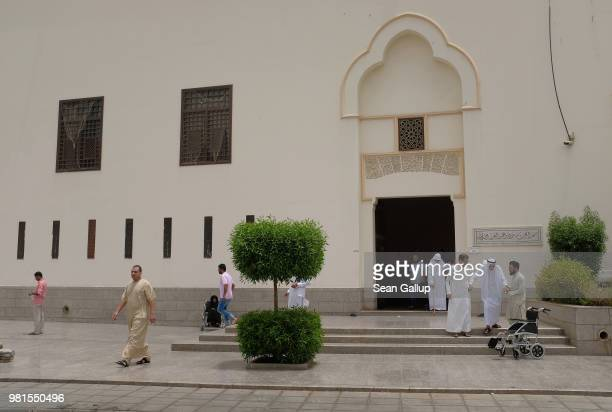 Men depart following Friday midday prayers at the King Saud mosque on June 22 2018 in Jeddah Saudi Arabia The Saudi government under Crown Prince...