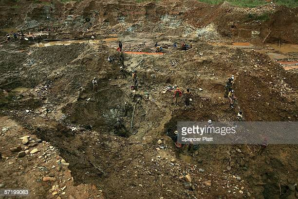 Men dig for gold at an abandoned industrial mine on March 28 2006 in Mongbwalu CongoThousands of Congolese scrape together meagre livings from mining...