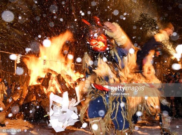 Men disguised as 'Namahage' perform a dance during the Namahage Sedo Festival at Shinzan Shrine in the northeastern Japan city of Oga Akita...