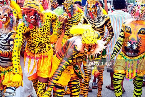 Men disguised as tiger during Onam