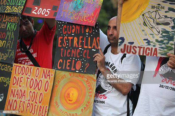 Men display banners during a rally in memory of the victim's of Cromanon at Plaza de Mayo on December 30 2014 in Buenos Aires Argentina Cromañ–on a...