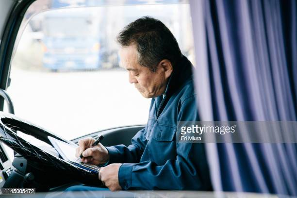 men doing notes in the track - old truck stock pictures, royalty-free photos & images