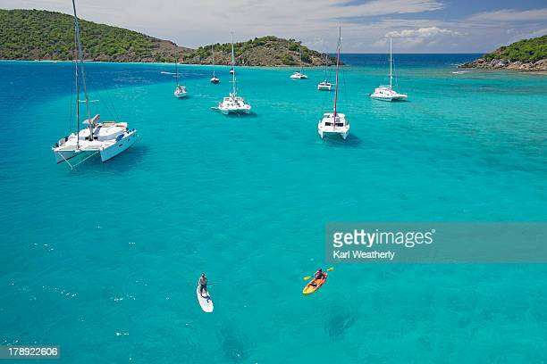 men doing water activities - catamaran stock photos and pictures