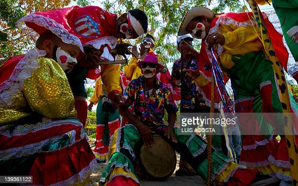 Men dresed as Congos play music before a carnival parade in Barranquilla Colombia on February 19 2012 Barranquilla's Carnival a tradition cretaed by...