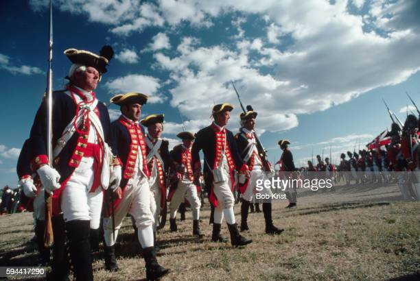men dressed as american revolutionary war soldiers marching during historical reenactment - yorktown stock pictures, royalty-free photos & images