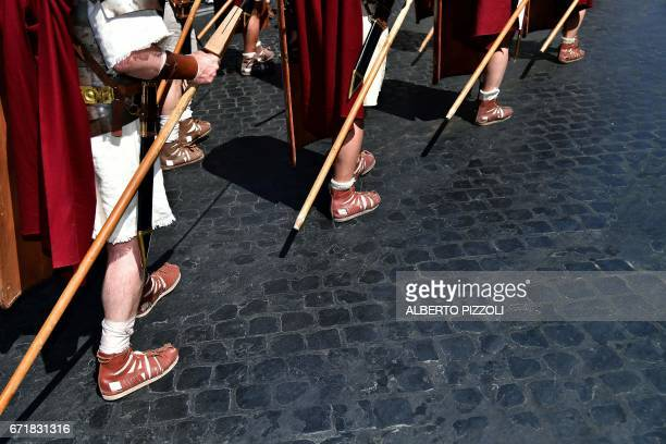 Men dressed as ancient Roman centurions parade to mark the anniversary of the foundation of Rome in 753 BC on April 23 2017 near the Imperial Forum...