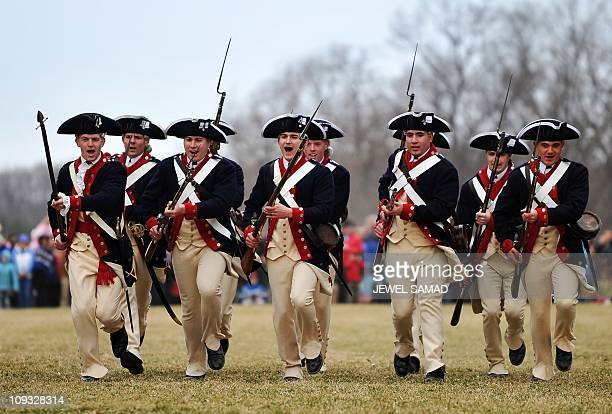 Men dressed as Continental Army soldiers demonstrate a fight during revolutionary war as they celebrate George Washington's birthday at Mount Vernon...