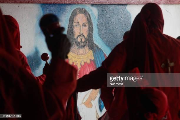 Men dressed as Devils dance and play maracas during the Corpus Christi celebration amid the Coronavirus pandemic in San Francisco de Yare, Miranda,...